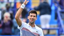 Djokovic battles past Young in Eastbourne quarters