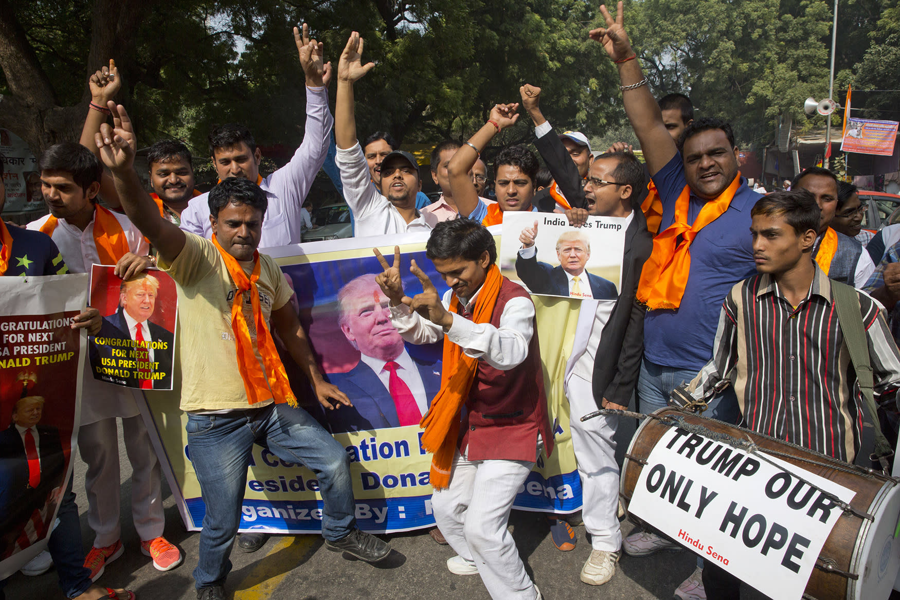 <p>Activists belonging to the Hindu Sena or Hindu Army, a local organization dance and celebrate in anticipation of the victory of U.S. presidential candidate Donald Trump in New Delhi, India, Wednesday, Nov. 9, 2016. (AP Photo/Manish Swarup) </p>