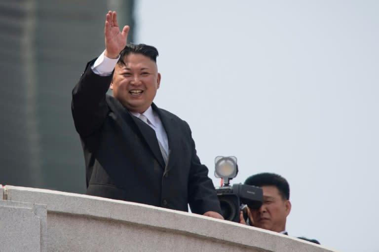 N.Korea paper shows photos of Kim's plant visit