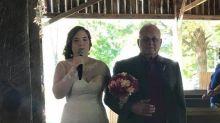 Bride singing her own Elvis processional makes her groom break down in tears