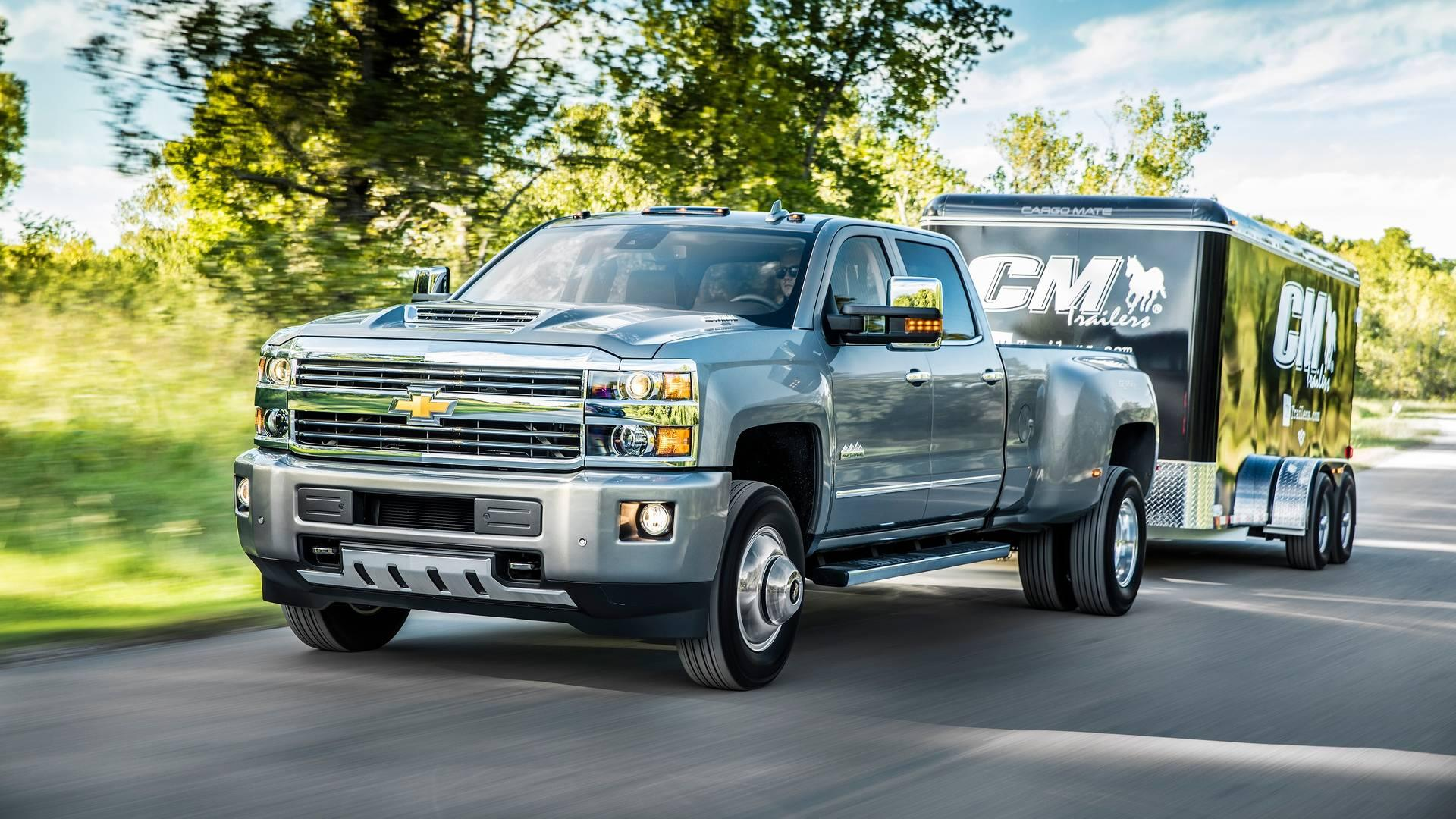 """<p>The heavy-duty pickup truck class of 2014 consisted of only four models, with the two General Motors entries receiving perfect scores for powertrain dependability from JD Power. Though the <a href=""""https://www.motor1.com/chevrolet/silverado-hd/"""" rel=""""nofollow noopener"""" target=""""_blank"""" data-ylk=""""slk:Silverado"""" class=""""link rapid-noclick-resp"""">Silverado</a> and <a href=""""https://www.motor1.com/gmc/sierra-hd/"""" rel=""""nofollow noopener"""" target=""""_blank"""" data-ylk=""""slk:Sierra HD"""" class=""""link rapid-noclick-resp"""">Sierra HD</a> three-quarter and one-ton models are mechanically identical, the Sierra gets below-average marks for body and interior dependability from JDP. According to <em>Consumer Reports</em> surveys, the 2014 models score above average in most regards, but get lower marks for minor engine problems, which CR defines as issues with """"accessory belts and pulleys, engine computer, engine mounts, engine knock or ping, (or) oil leaks.""""</p>"""