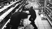 Shopkeeper fights off thief with champagne bottle