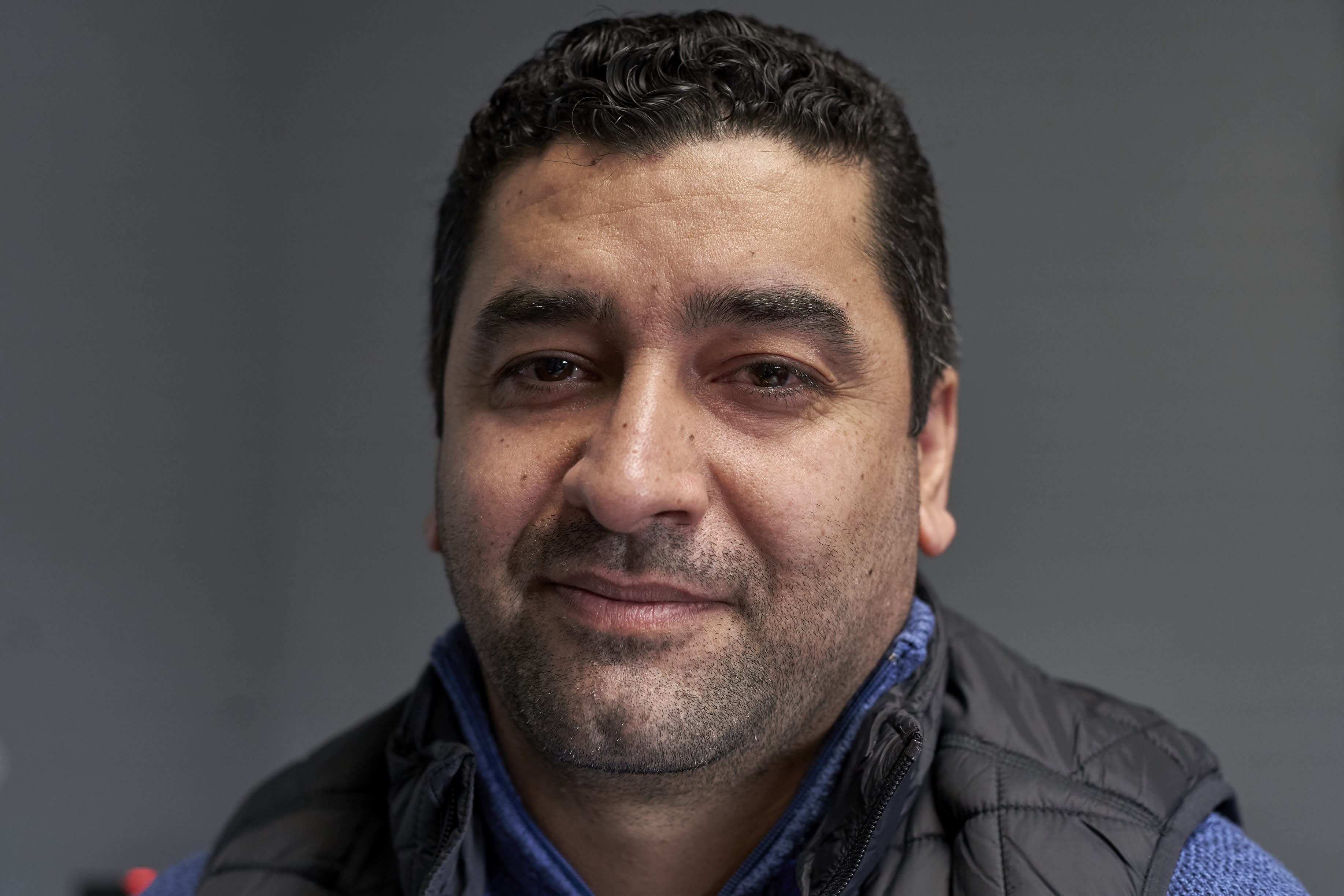 In this Dec. 19, 2019 photo, Hatim Ido poses for a photo in Lincoln, Neb., following an interview with the Associated Press. Neb. Gov. Pete Ricketts announced he would continue to allow refugees to settle in Nebraska, and in an open letter praised President Trump for adding new security layers to the vetting process. The uncertainty prior to that announcement was a major worry for Hatim Ido, a graduate student in Lincoln, Neb., who fled from Iraq to the United States after working as a translator for the U.S. Army. AP Photo/Nati Harnik)