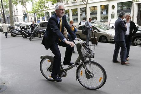 British Cycling President Brian Cookson rides a Velib self-service public bicycle during a photo session after a news conference in Paris