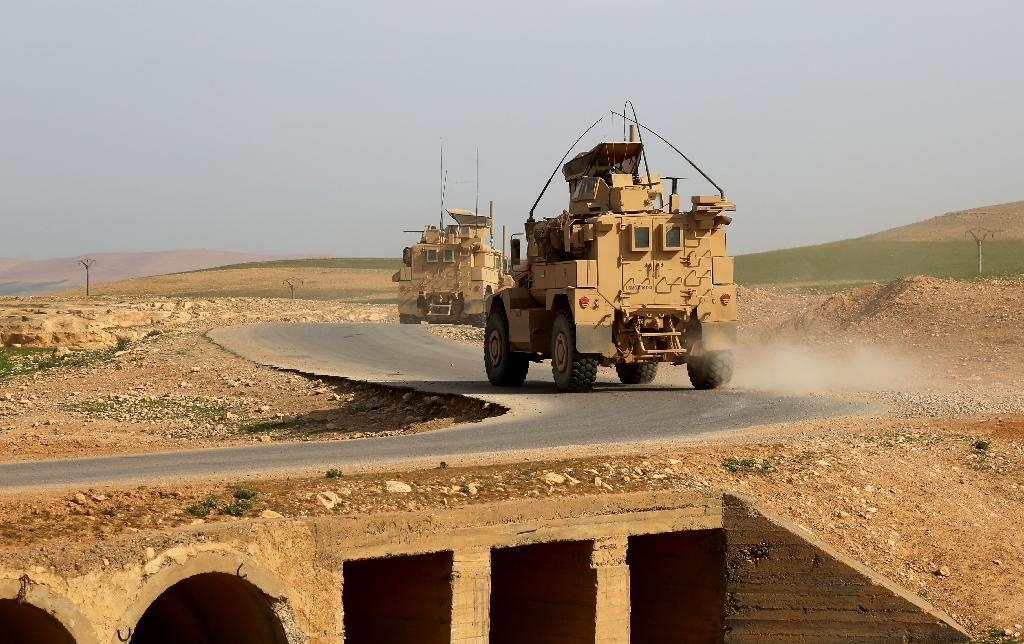 US-made armoured vehicles bearing markings of the US Marine Corps are seen on a road north of Raqa in northern Syria on March 27, 2017 (AFP Photo/Delil SOULEIMAN)