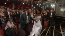 Chris Evans wins the internet's heart after he chivalrously helps Regina King onstage at the Oscars