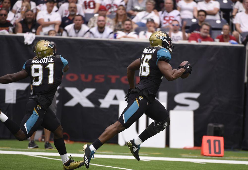 Jacksonville Jaguars defensive end Dante Fowler (56) returns a fumble for a touchdown against the Houston Texans. (AP)