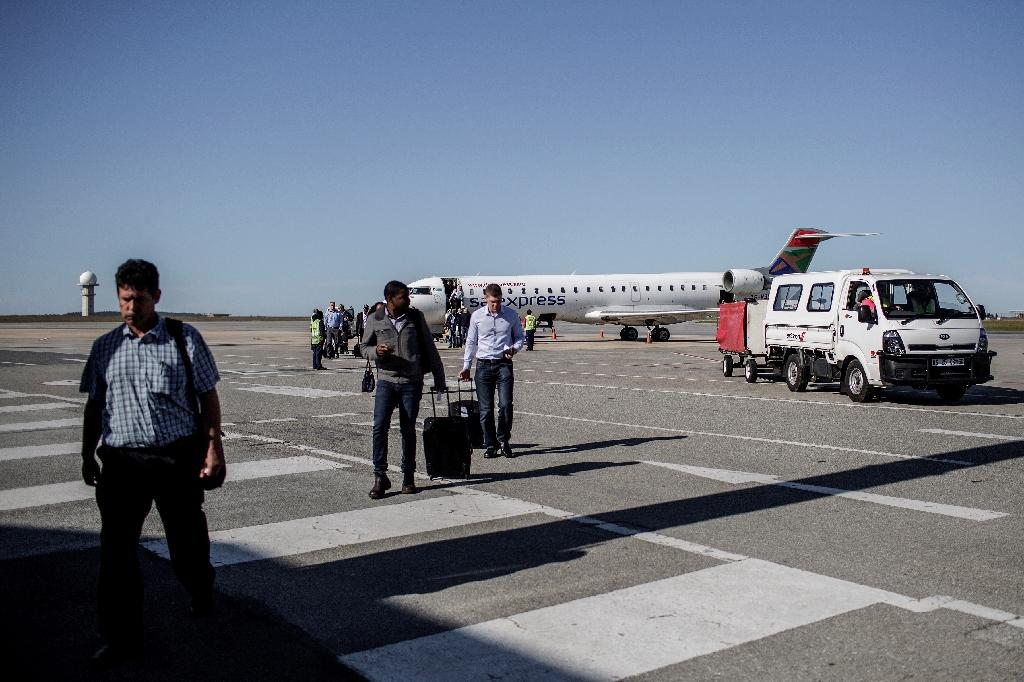 Passengers disembark from a South African Express flight at George airport (AFP Photo/Gianluigi Guercia)
