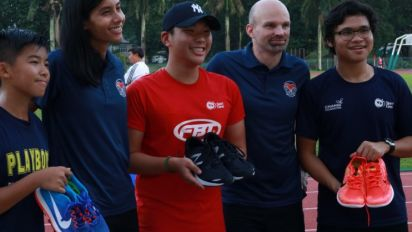 Donated sports shoes give needy kids a spring in their step