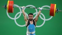 Olympic weightlifting champion charged with swapping urine samples