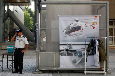 Japanese Ground Self-Defense Force's recruiter stands in front of a promotional booth during a public relations event to attract recruits in Tachikawa, western Tokyo, Japan August 26, 2018. REUTERS/Kim Kyung-Hoon