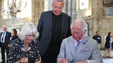 Prince Charles and Camilla go mask-free indoors during 'freedom day' engagements