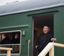 The Latest: Kim upbeat on eve of 1st summit with Putin