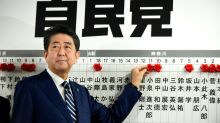 Abe targets N. Korea after storming to 'super-majority' vote win