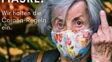 Berlin tourism advert showing old woman giving the finger gets pulled