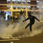 Hong Kong police launch tear gas at protesters as democracy march descends into chaos