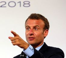 Macron tells global tech CEOs: 'There is no free lunch'