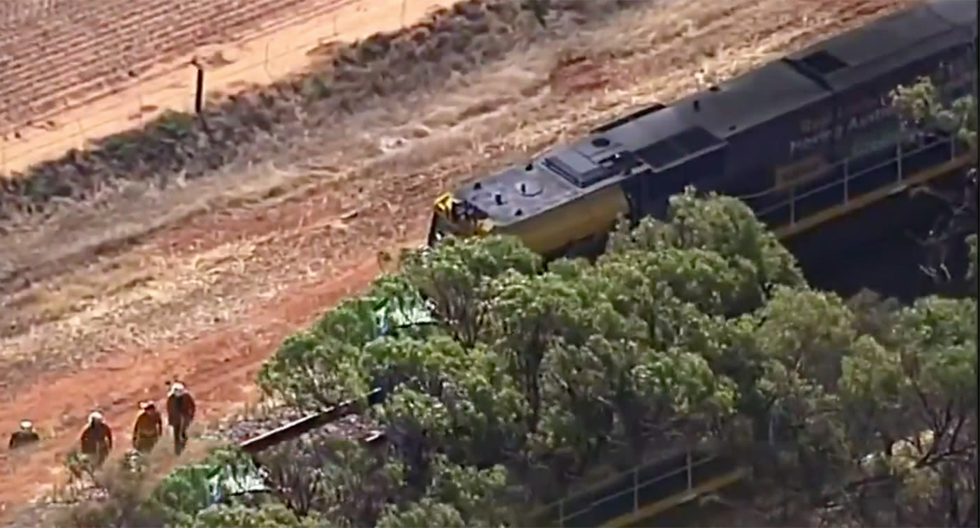 Freight train crashes into car on track