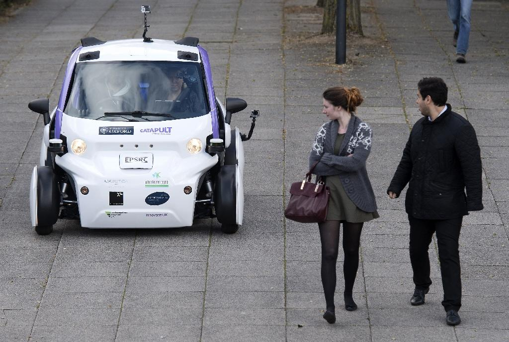 An self-driving vehicle being tested in a pedestrian zone of London