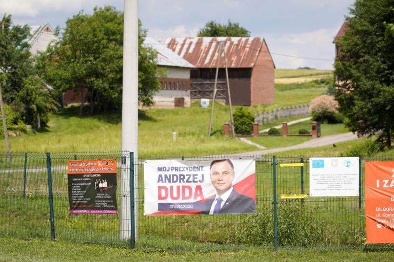 A campaign poster bearing a portrait of President Duda is displayed on a fence in Godziszow, a bedrock of his conservative administration (AFP Photo/Jaap Arriens)