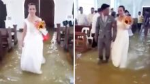 Bride refuses to let a flooded church stop wedding