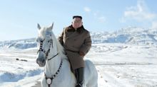 Kim Jong Un rides white horse up sacred mountain in stunt aimed at US