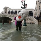 Flood-stricken Venice hit by fresh high tide, leaving most of city under water