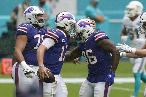 Buffalo Bills quarterback Josh Allen (17) congratulates tight end Reggie Gilliam (86) after Gillam scored a touchdown, during the first half of an NFL football game against the Buffalo Bills, Sunday, Sept. 20, 2020, in Miami Gardens, Fla. (AP Photo/Lynne Sladky)