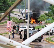 Cartel gunmen terrorize Mexican city, free El Chapo's son