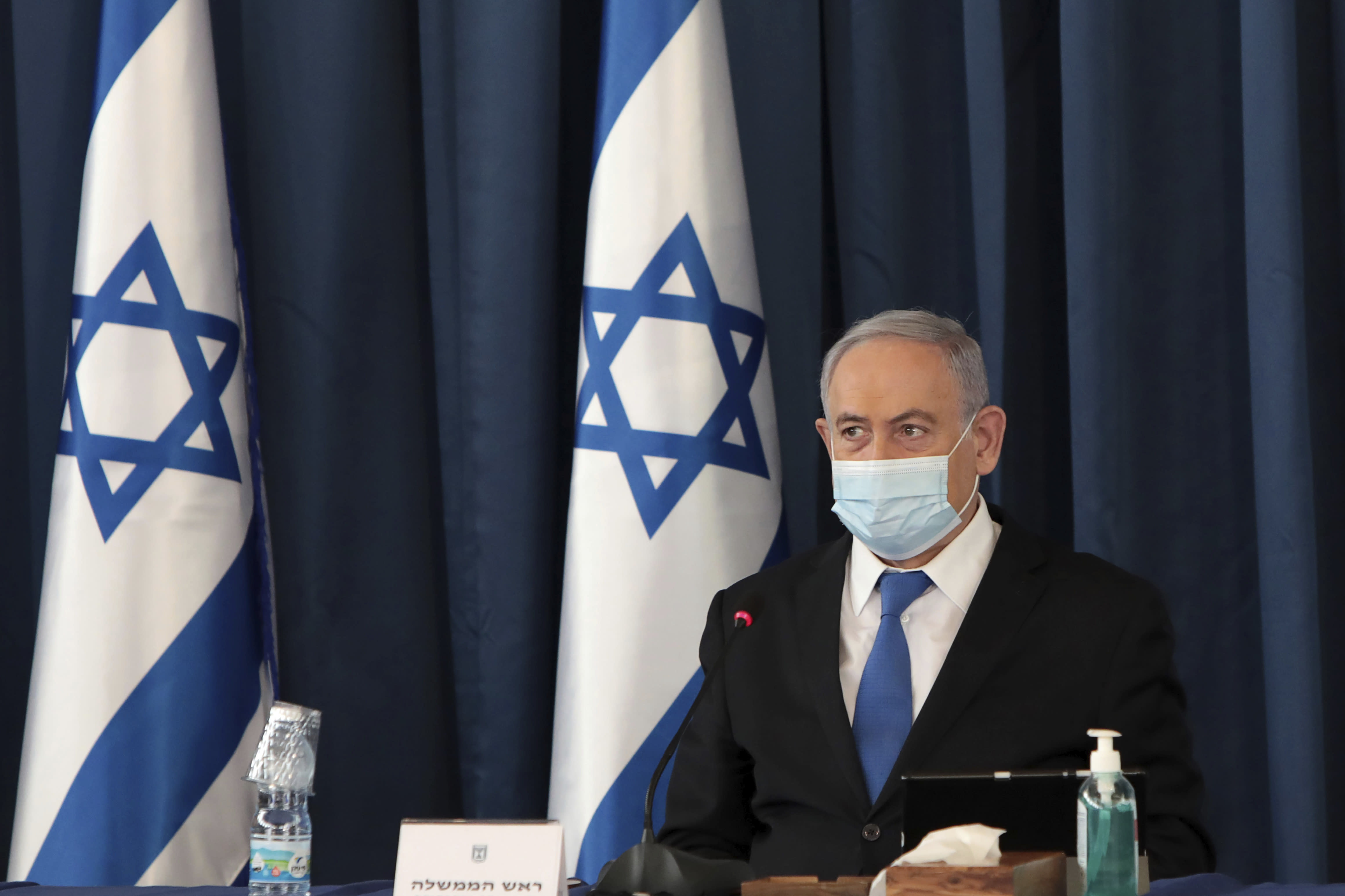 Israeli Prime Minister Benjamin Netanyahu wears a face mask to help prevent the spread of the coronavirus as he opens the weekly cabinet meeting, at the foreign ministry, in Jerusalem, Sunday, July 5, 2020. (Photo by Gali Tibbon/Pool via AP)