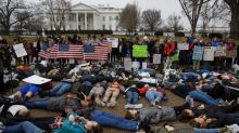Teens hold lie-down protest near White House in Washington