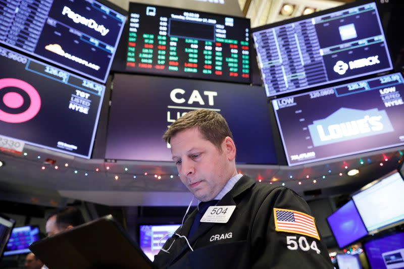 Global stocks hover near record highs, gold breaches $1,500