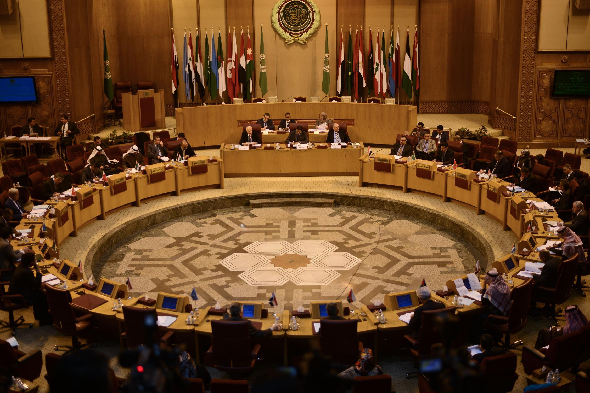 Representatives of the Arab League attend an emergency meeting to discuss the conflict in Libya, at the Arab League headquarters in Cairo on January 5, 2015