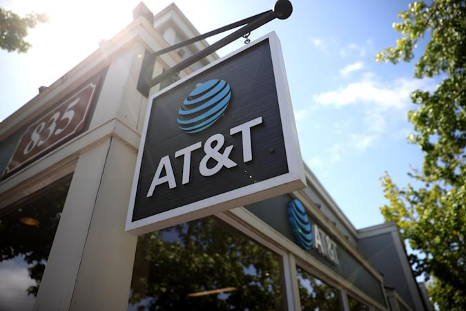 SAN RAFAEL, CALIFORNIA - MAY 17: A sign is posted in front of an AT&T retails store on May 17, 2021 in San Rafael, California. AT&T,  the world's largest telecommunications company, announced a deal with Discovery, Inc. which will spin off AT&T's WarnerMedia and be combined with Discovery to create a new standalone media company. (Photo by Justin Sullivan/Getty Images)