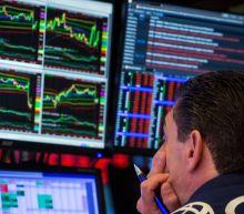 EXPLAINER-Global market rout triggers trading suspension debate