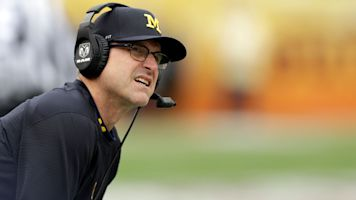 Harbaugh offers middle school QB a scholarship