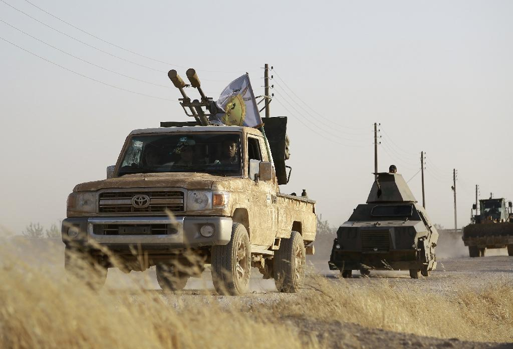 US-backed Kurdish and Arab fighters advance into the Islamic State jihadist's group bastion of Manbij, in northern Syria, on June 23, 2016