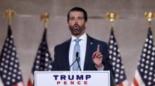 Trump Jr retweets post saying 'DOJ is dropping the hammer' as 74 face federal charges over Portland protests