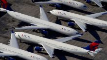 Delta takes $3 billion charge on buyouts, American Airlines workers brace for furlough warnings