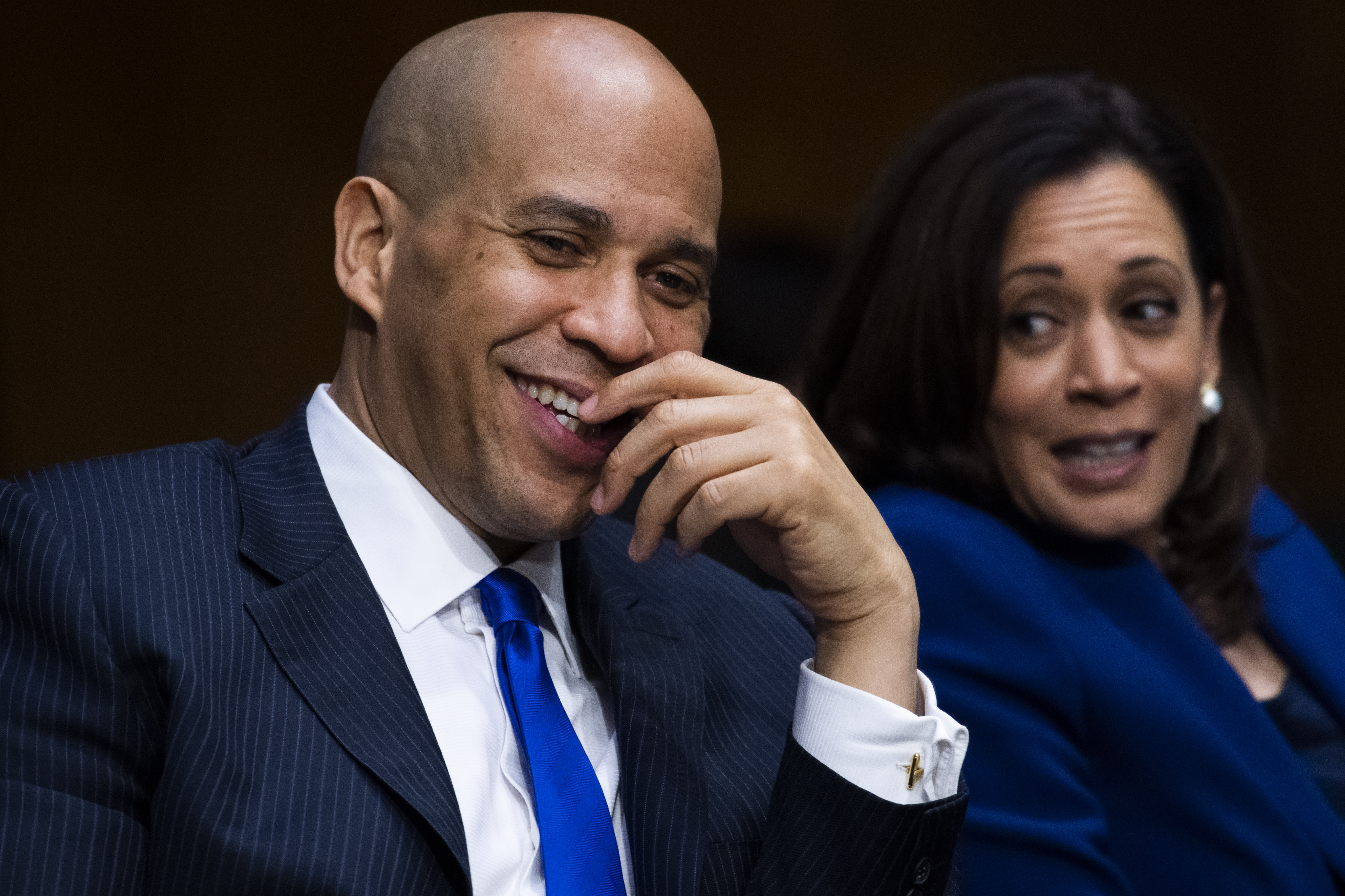 Sen. Cory Booker, D- N.J., speaks with Sen. Kamala Harris, D-Calif., during a Senate Judiciary Committee hearing on police use of force and community relations on on Capitol Hill, Tuesday, June 16, 2020 in Washington. (Tom Williams/CQ Roll Call/Pool via AP)