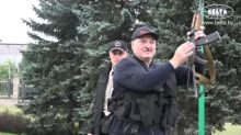 Belarus leader replaces security chiefs as Russia PM visits
