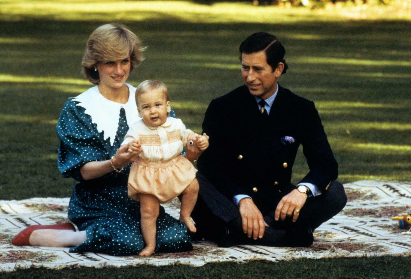 Diana and Charles enjoy a family day out.