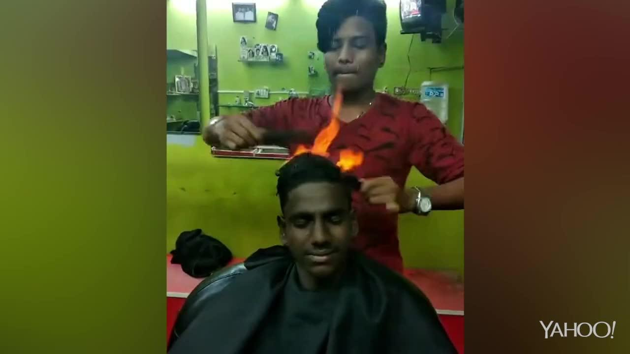 Barber Gives Customer A Haircut Using Fire And Two Combs Video
