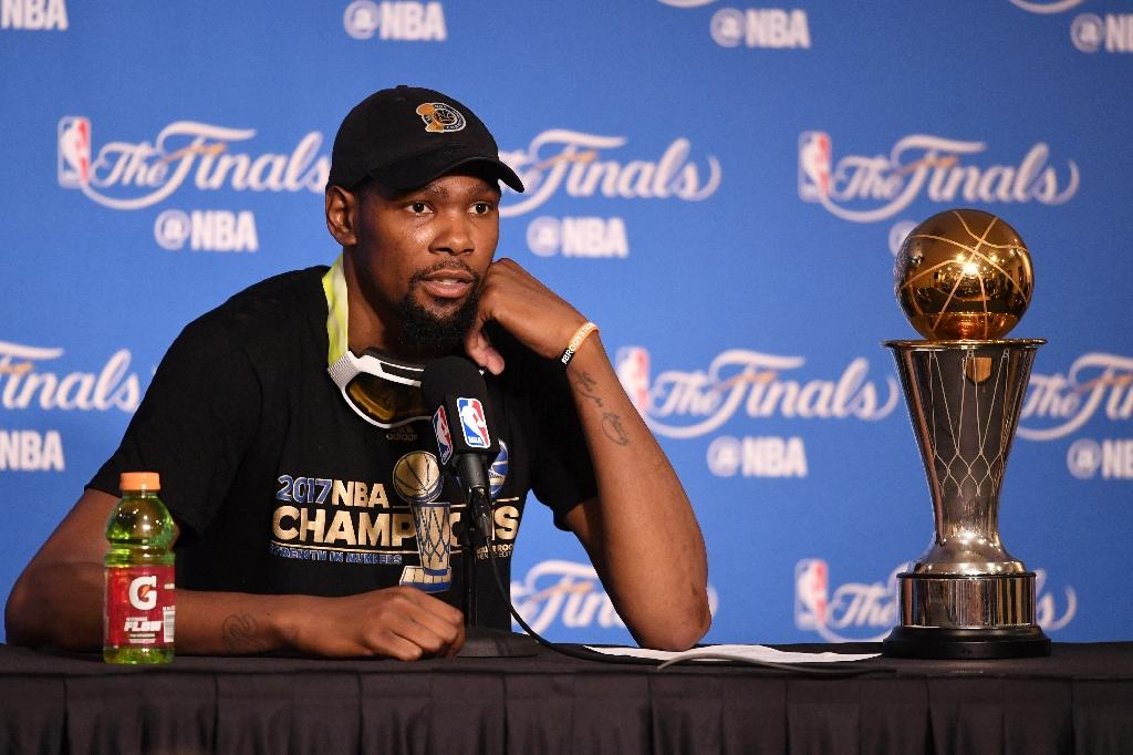 Kevin Durant of the Golden State Warriors speaks at the press conference after his teams 129-120 victory over the Cleveland Cavaliers in Game 5 to win the 2017 NBA Finals at ORACLE Arena on June 12, 2017 in Oakland, California