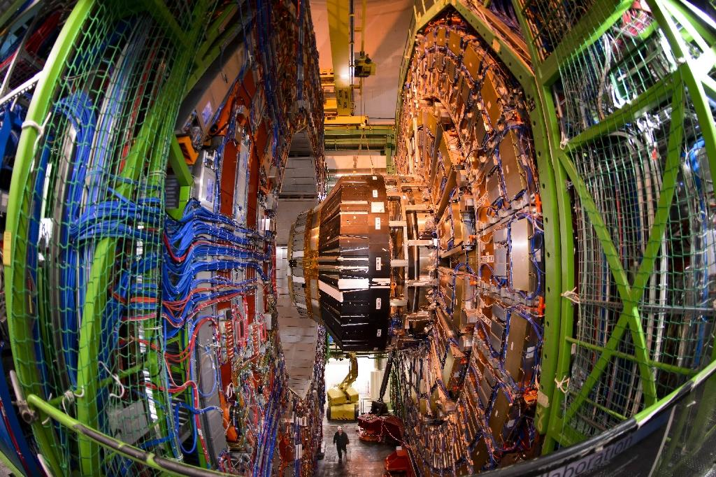 A worker stands below the Compact Muon Solenoid (CMS), a general-purpose detector at the European Organisation for Nuclear Research (CERN) Large Hadron Collider (LHC), during maintenance works on July 19, 2013 in Meyrin, near Geneva (AFP Photo/FABRICE COFFRINI)