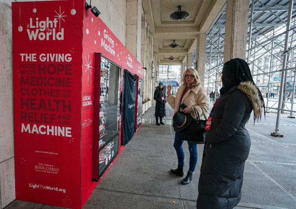The idea is simple: instead of snacks, the vending machines sell brightly colored boxes with prices ranging from two to 200 dollars, illustrating the needs of poor families at home and abroad (AFP Photo/Don EMMERT)