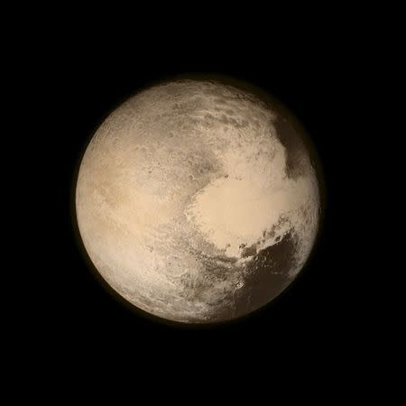 Pluto nearly fills the frame in this image from the Long Range Reconnaissance Imager (LORRI) aboard NASA's New Horizons spacecraft, taken on July 13, 2015 when the spacecraft was 476,000 miles (768,000 kilometers) from the surface. NASA/Handout via REUTERS