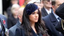 Meghan Markle looks somber in navy for Field of Remembrance debut at Westminster Abbey