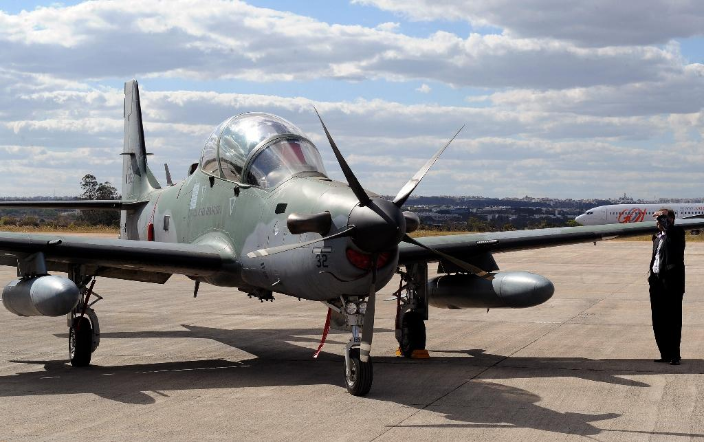A Super Tucano aircraft on display during a defense fair at Brasilia's Air Base in 2012