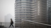 China's Fosun Reviews 9,000 Deals, Does 100